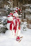 Snowman couple in love - christmas outdoor decoration with snow Royalty Free Stock Photo