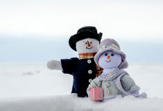 Snowman couple  pose in the snow Royalty Free Stock Photo