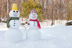 Snowman couple. 2 snowmen outdoors Royalty Free Stock Image