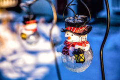 Snowman. Couple of snowman solar lights royalty free illustration