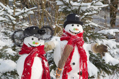 Snowman couple in winter - christmas outdoor decoration with sno Royalty Free Stock Image