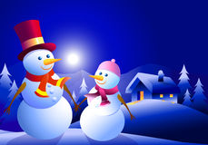 Snowman couple at winter night Royalty Free Stock Image