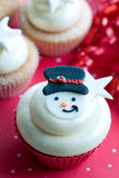 Snowman cupcake. Festive cupcake decorated with a sugar snowman Royalty Free Stock Photo