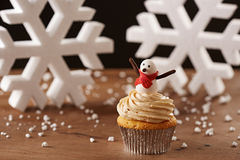 Snowman cupcake on Christmas background Royalty Free Stock Images
