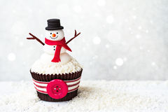 Snowman cupcake. With copyspace to side Royalty Free Stock Image