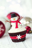 Snowman cupcake. Cupcake decorated with a fondant snowman Royalty Free Stock Image