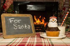 Snowman cupcake and milk Royalty Free Stock Photography