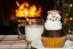 Snowman cupcake and milk Stock Image