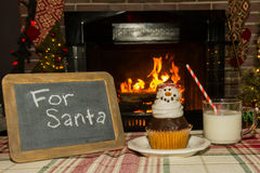 Snowman cupcake and milk Stock Photography