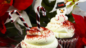 Snowman and candy cane cupcakes Stock Images