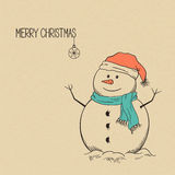 Snowman. Cute hand drawn snowman over rough brown paper texture for Christmas and winter design Royalty Free Stock Photo