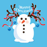 Snowman with decorated antlers Royalty Free Stock Photos