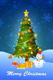 Snowman with decorated pine tree for Merry Christmas Royalty Free Stock Photography
