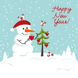 The snowman decorates a Christmas tree hearts Royalty Free Stock Photo