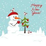 The snowman decorates a Christmas tree hearts.  Royalty Free Stock Photo