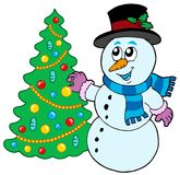 Snowman decorating Christmas tree Royalty Free Stock Photography