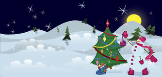 Snowman is decorating Christmas tree banner Stock Photography