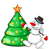 Snowman decorating Christmas tree Royalty Free Stock Photo