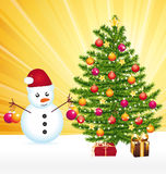 Snowman decorating a joyful christmas tree. Stock Images