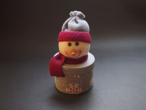 Snowman decoration. On black background Royalty Free Stock Image