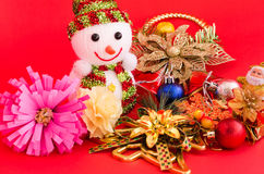 Snowman and decoration of christmas on red background Royalty Free Stock Photo