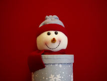 Snowman decoration. On red backgroun Royalty Free Stock Images