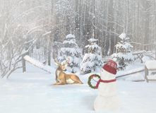 Snowman and deer with Christmas ornaments in mist Royalty Free Stock Photos