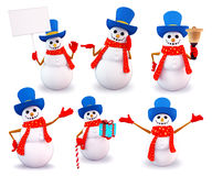 Snowman in different poses with sign Royalty Free Stock Photos