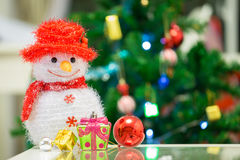 Snowman doll, gift box and red ball. Royalty Free Stock Photo