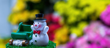 Snowman. Doll and sledding for christmas decoration with blur background Royalty Free Stock Photography