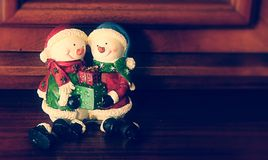 Snowman dolls with gifts in their hands Stock Image