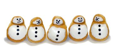 Snowman Doughnuts. Dough-nuts with icing to look like happy snowmen Royalty Free Stock Photo
