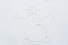 Snowman drawing on snow surface Royalty Free Stock Photos
