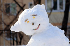 Snowman at the end of winter on the Playground Stock Image