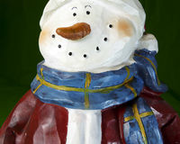 Snowman face. Close-up of a wooden snowman Christmas decoration Royalty Free Stock Photos