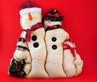 Snowman Family. On red background royalty free stock photo