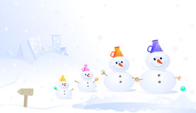 Snowman family. The Snowman family gathered near the town on the hill Royalty Free Stock Image