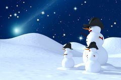 Snowman Family. Family of snowmen  look at the star comet Royalty Free Stock Photos