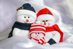 Snowman Family - Christmas Stock Photo. Snowman Family - Happy Christmas Snowmen Family on White Snow Background stock images
