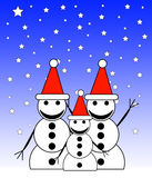 Snowman Family At Night 6. A family of happy snowmen at night Royalty Free Stock Image