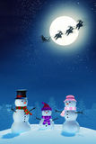 Snowman family and Santa in moonlit winter landscape at night Stock Images