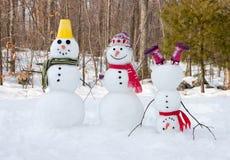 Snowman family. 3 snowmen outdoors Stock Photo