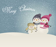 Snowman family on winter background Royalty Free Stock Photo