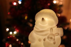 Snowman among festive lights Royalty Free Stock Photos