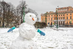 Snowman on the Field of Mars. Field of Mars, Mikhailovskiy (Engineers') Castle in distance. St.-Petersburg, Russia Stock Photo