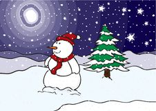 Snowman in a field at night Stock Photo