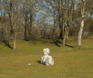 Snowman on field with no snow anymore around Stock Images
