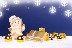 Snowman figure and golden ornaments Royalty Free Stock Photo