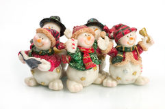Snowman figures. Miniature Snowman statues in different poses against white background with clipping paths royalty free stock photo