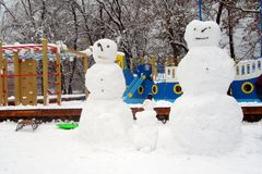 Snowman. The figures are fashioned out of snow on a city street in Kyiv. Collective children`s creativity. Ukraine royalty free stock photo